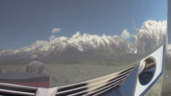 George and the Tetons reflected off the front of the trailer