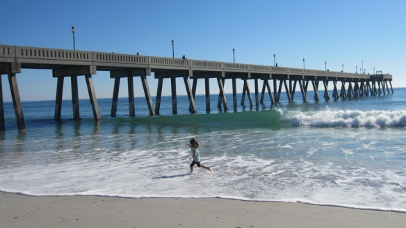 Our middle munchkin ecstatically running in the waves.