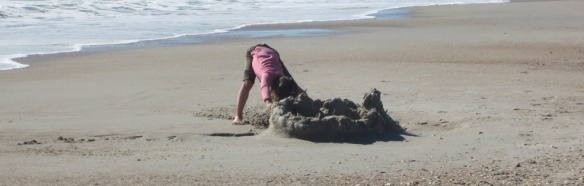 Another worked on a sand castle.