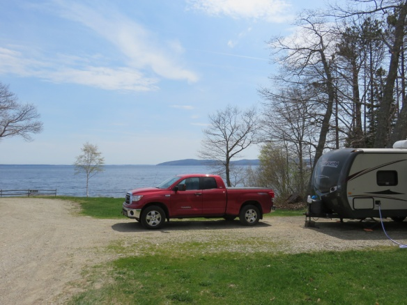 Our truck one year later in Belfast, Maine.  It's enjoying a gorgeous oceanfront site and waits patiently while we eat fresh steamers and fried clams at the campground's restaurant.