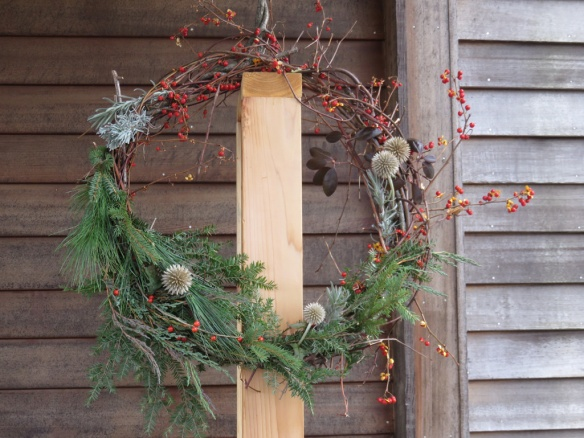 I wanted to make a wreath without using any wire or frame. This is the funky result--a mullet wreath, business on one side, party on the other. Maybe I should hang it on the truck's grille to scare away the mice.